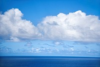 Horizon of Pacific ocean and blue sky with clouds