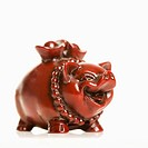 Chinese pig figurine on white background