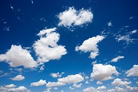 Fluffy cumulus clouds in blue sky
