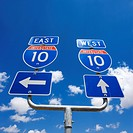 Highway interstate 10 sign with arrows pointing east and west