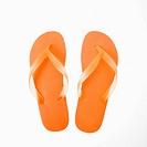 Orange plastic thong flip flops