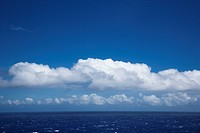 Pacific ocean with white puffy clouds