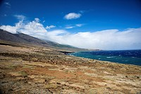 Barren landscape leading to Pacific ocean in Maui, Hawaii