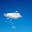 Single fluffy cloud in blue sky