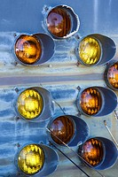 Old taillights together on metal blue background