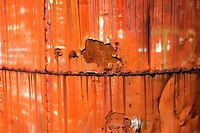 Closeup of metal orange container