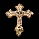 Ornamental religious cross against black background