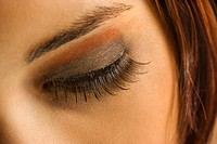 Close up of young Caucasian woman's eye with makeup