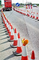 Red cones on a motorway slip road