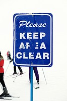 Sign at ski slope requesting area be kept clear (thumbnail)