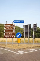 Road signs pointing different directions, Tuscany (thumbnail)