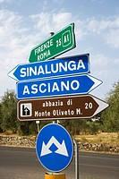 Road signs pointing different directions in Tuscany, Italy (thumbnail)