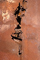 Close_up of old rusted car with crack down the middle