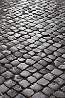 Close_up of cobblestone street in Rome, Italy
