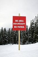 Boundary sign at ski slope warning of no patrol