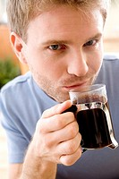 Man drinking black coffee (thumbnail)