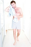 smiling man drying himself with a towel