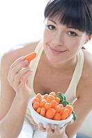 woman with bowl of carrots
