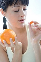 woman with orange and vitamin