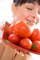 woman holding tomatos