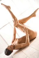 nude woman laying with legs up
