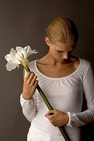 Young woman with lily (thumbnail)