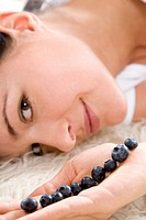 woman with blueberries on hand