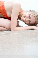 cheerful woman lying on the beach