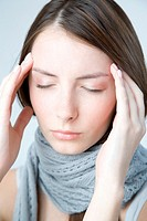 Young woman with headache (thumbnail)