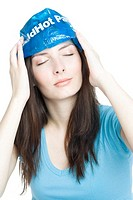 young woman with cold compress on forehead