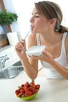 young woman eating joghurt