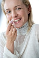 Woman applying lip balm (thumbnail)