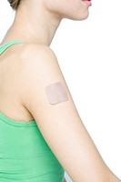 young woman with contraception patch