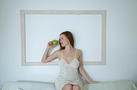 Young woman with apple (thumbnail)