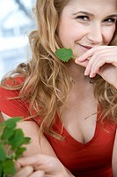 Young woman with mint leaf (thumbnail)