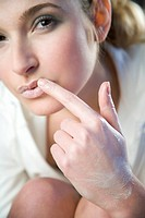 woman putting cream on lips