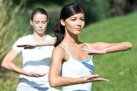 Young women exercising in park (thumbnail)