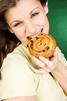 Young woman eating yeast_cake