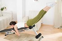 young woman doing streaching exercising