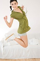 Happy young woman jumping (thumbnail)