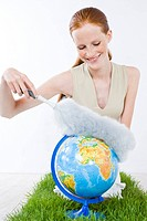 woman cleaning globe