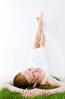 Beauty woman laying on grass (thumbnail)