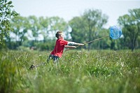 boy playing on meadow