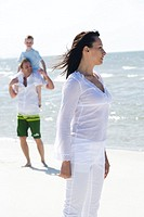 Family walking on beach (thumbnail)
