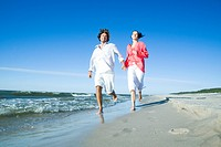 couple running on seaside