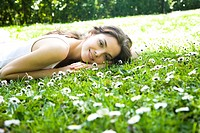 Woman laying on the grass