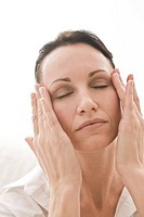 woman massaging face