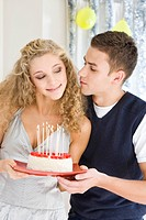 Couple with birthday cake (thumbnail)