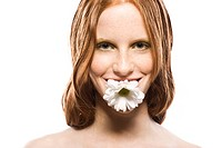 Young woman with flower in mouth (thumbnail)