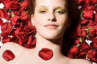 beauty woman on roses patals